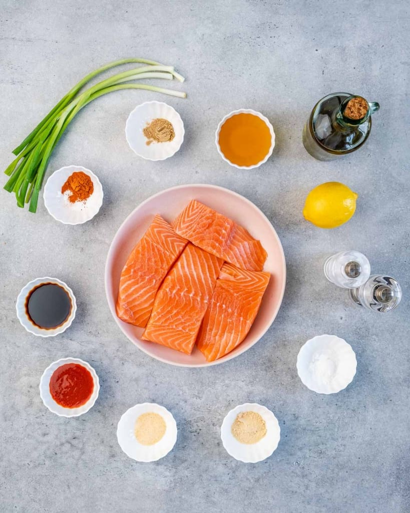 ingredients to make the honey glazed salmon lined up on a flat surface