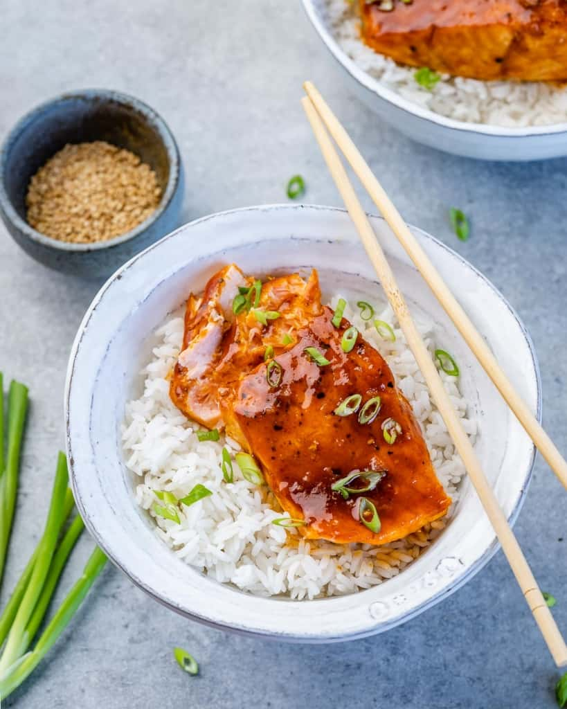 top view of honey salmon filet over a bowl of white rice