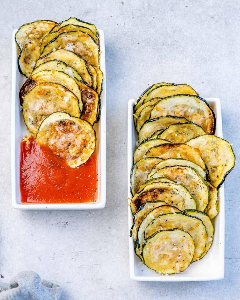 two small bowls of zucchini chips, one of them with marinara sauce
