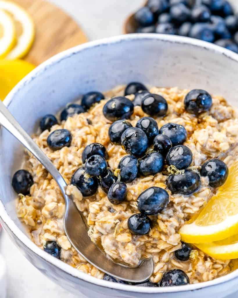 one bowl with blueberries and lemon wedges