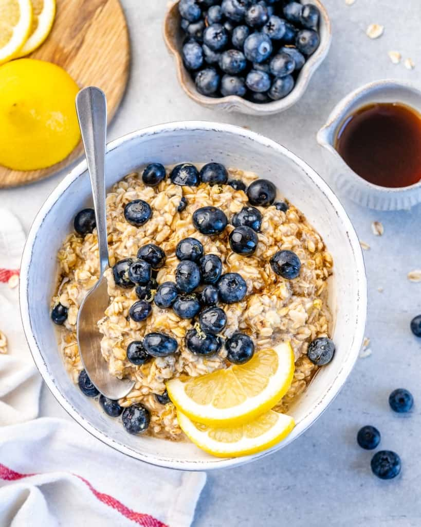 blueberry overnight oats in one bowl with lemon and blueberries