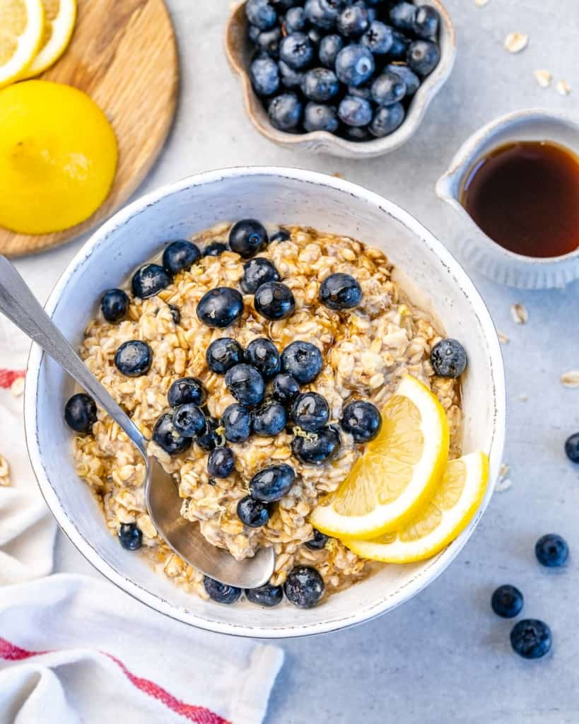 one bowl of blueberry overnight oats with blueberries and lemon