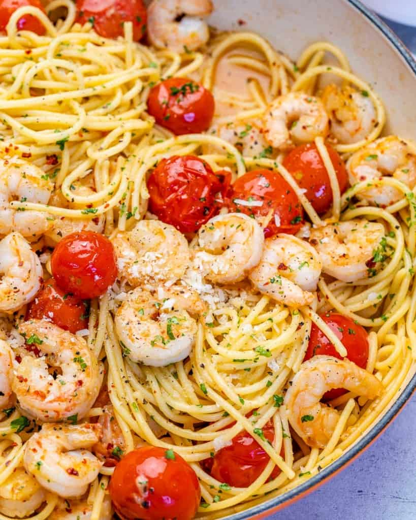 side shot of pasta with cherry tomatoes  and shrimp