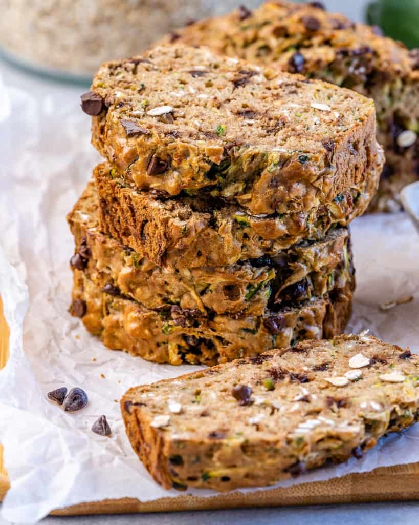 stacks of zucchini bread slices on a parchment paper