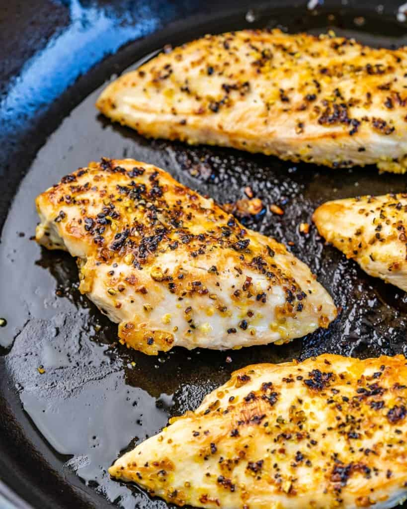 cooked chicken breast on a pan