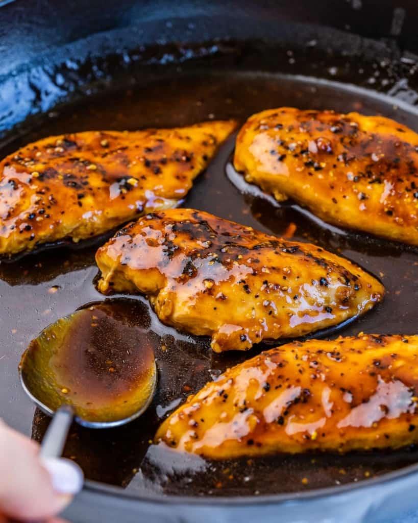 side shot of chicken breast in honey glazed garlic sauce