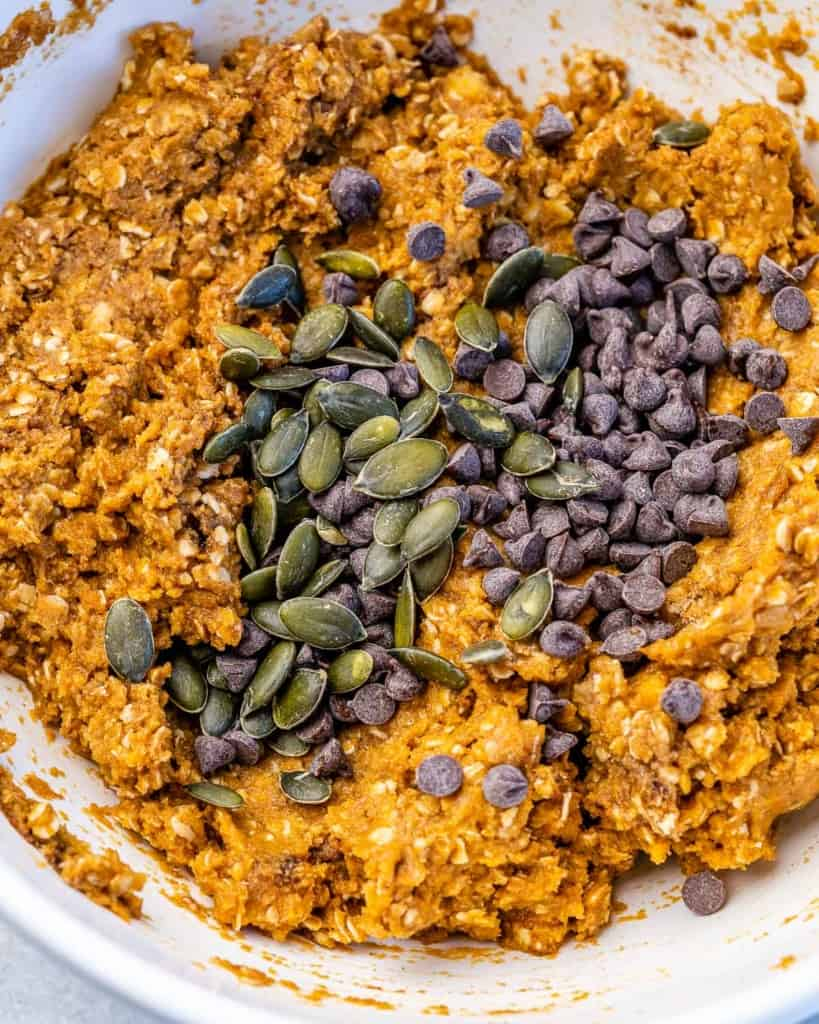pumpkin seeds and chocolate chips added over oatmeal batter