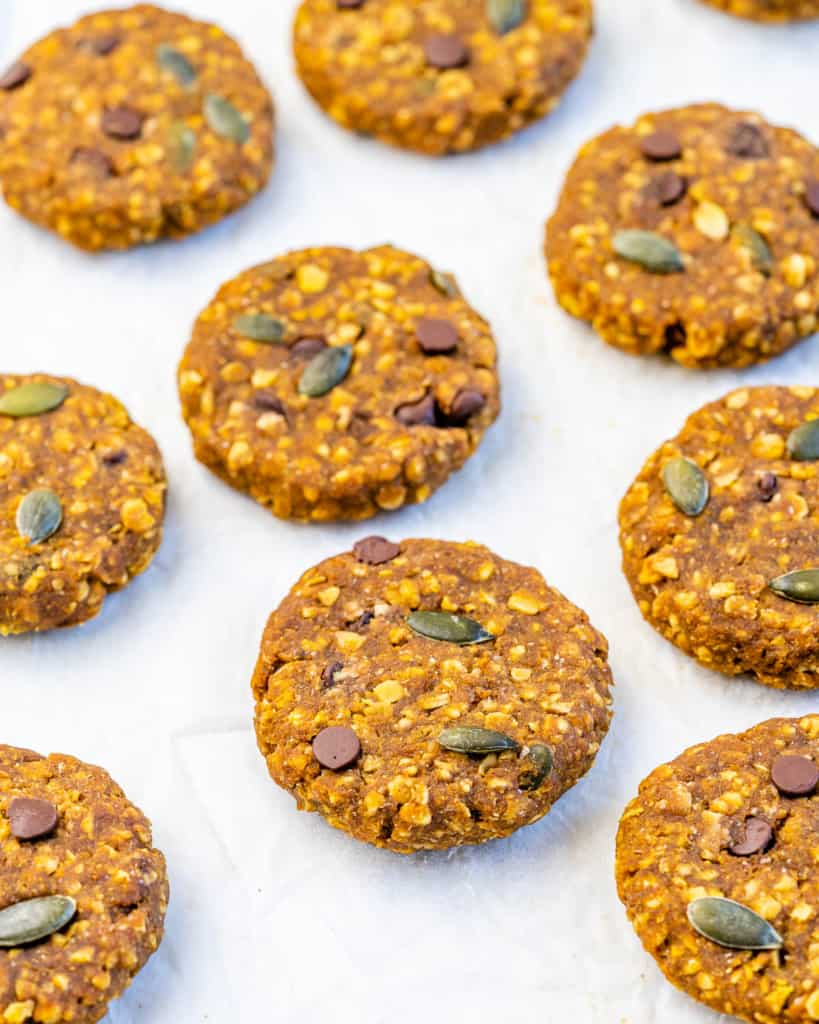 side shot of pumpkin oatmeal cookies on parchment paper