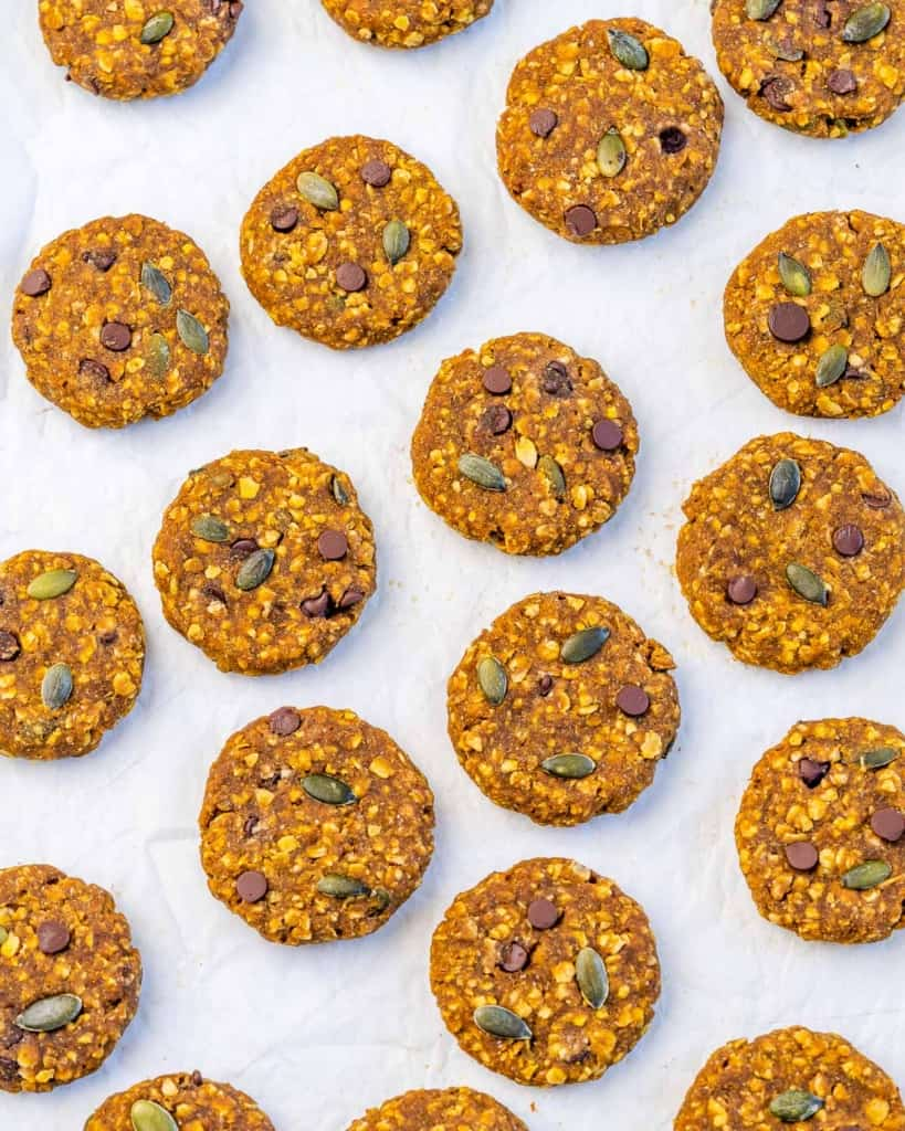 top view of oatmeal cookies laid flat on parchment paper