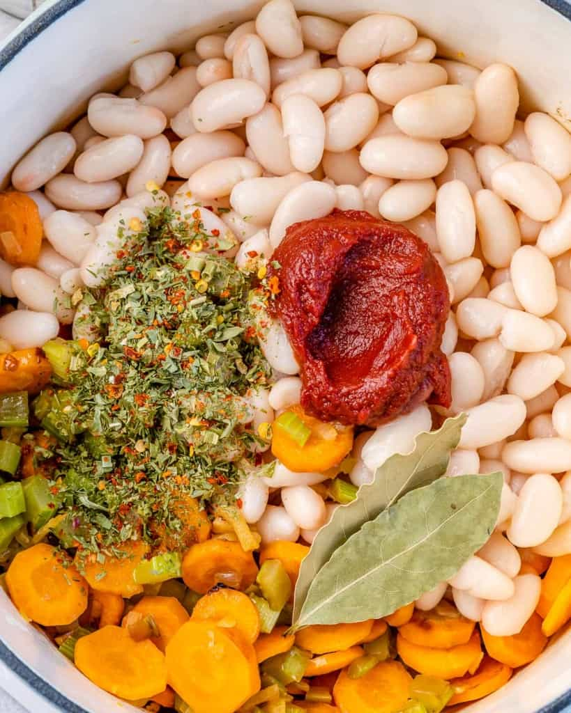 white beans, herbs, and tomato paste added over sauteed veggies
